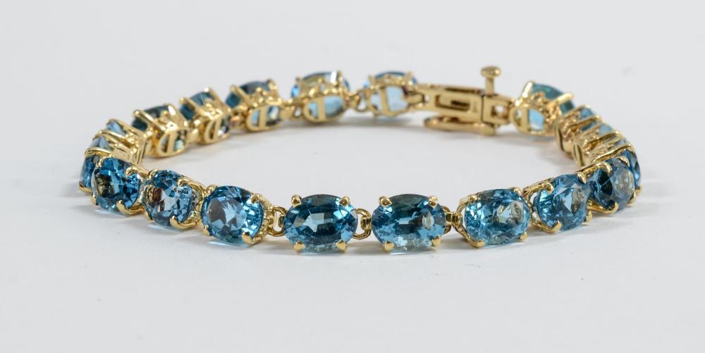 Ladies 14K Blue Topaz Tennis Bracelet