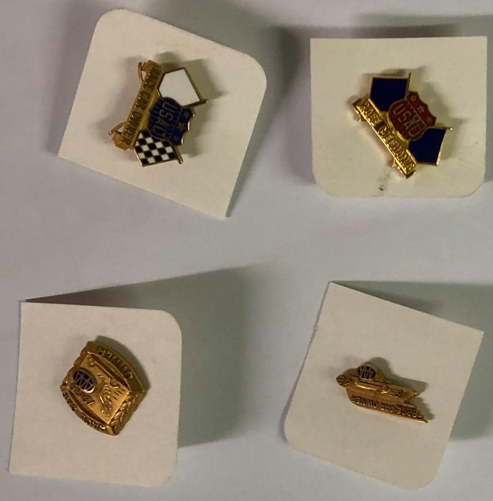 Four small gold pins - two AAA, two USAC