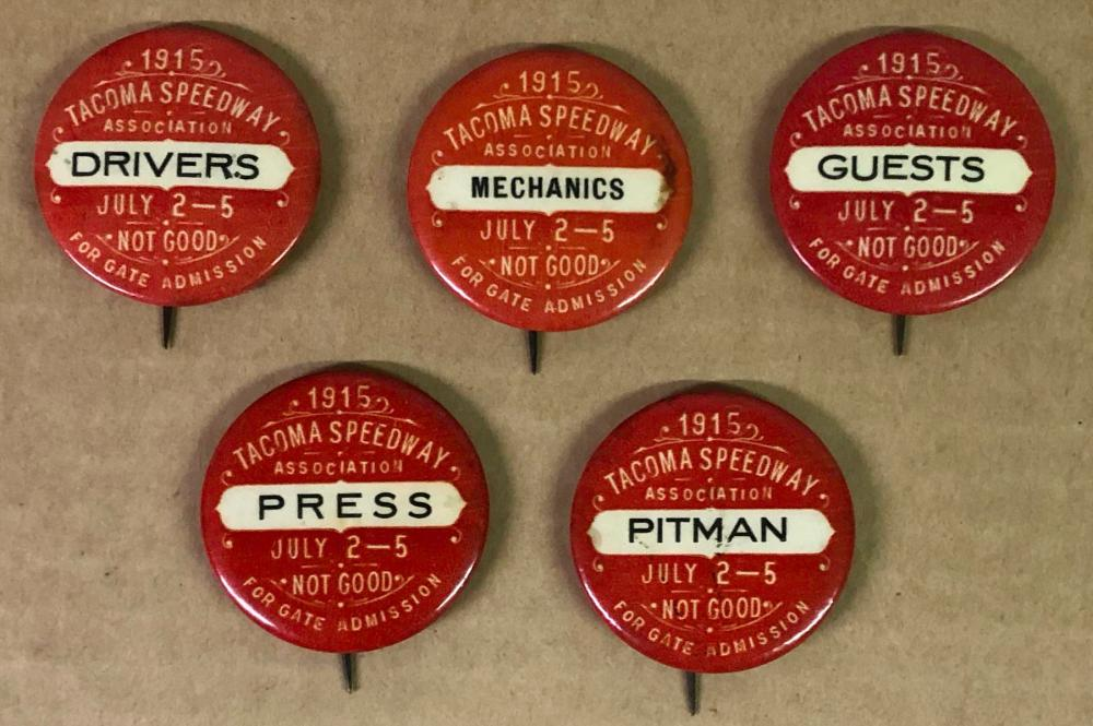 Five 1915 Tacoma Speedway red round pins
