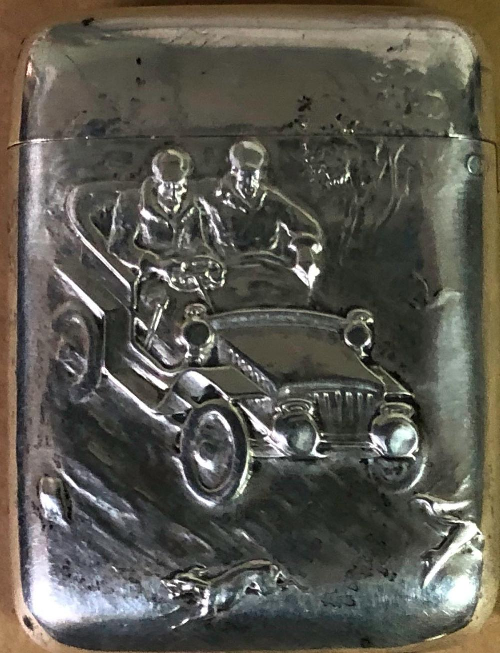 Silver match case with early car and passengers