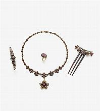 A set consisting of a comb, collier, bracelet and a ring with garnets