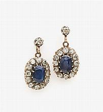 A pair of saphire and diamond earrings