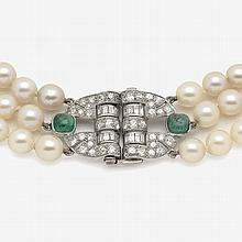 A three-stranded collier with Akoya cultured pearls and a clasp of an Art Deco design