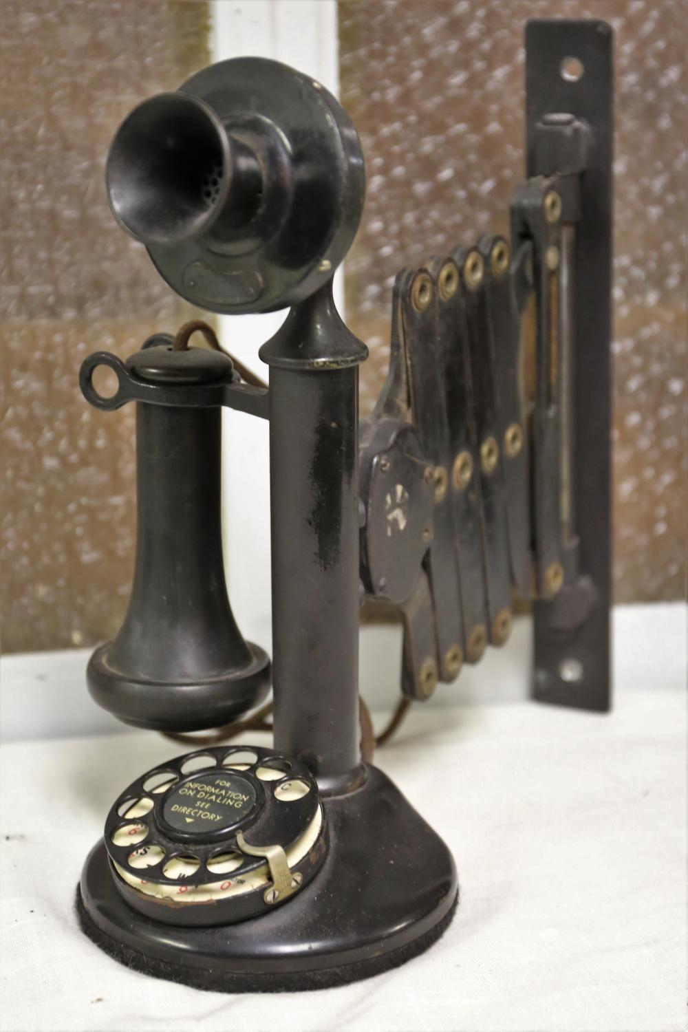 Vintage candlestick phone with wall mount extender