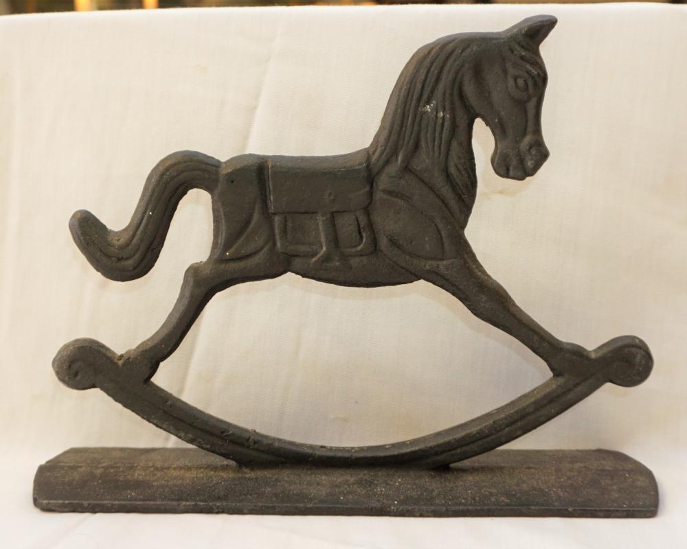 Cast iron rocking horse door stop