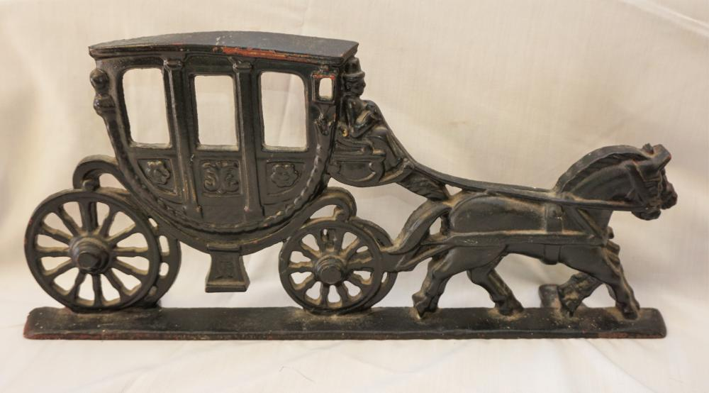 Cast iron horse and carriage door stop