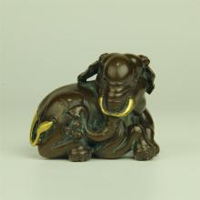 CHINESE PARTIAL GILT BRONZE SEATED ELEPHANT