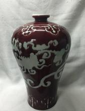 CHINESE PORCELAIN RED GROUND WHITE DRAGON MEIPING VASE