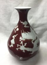 CHINESE PORCELAIN RED GROUND WHITE DRAGON YUHUCHUN VASE