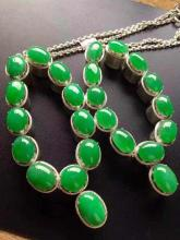 TWO NATURAL JADEITE BEAD NECKLACES