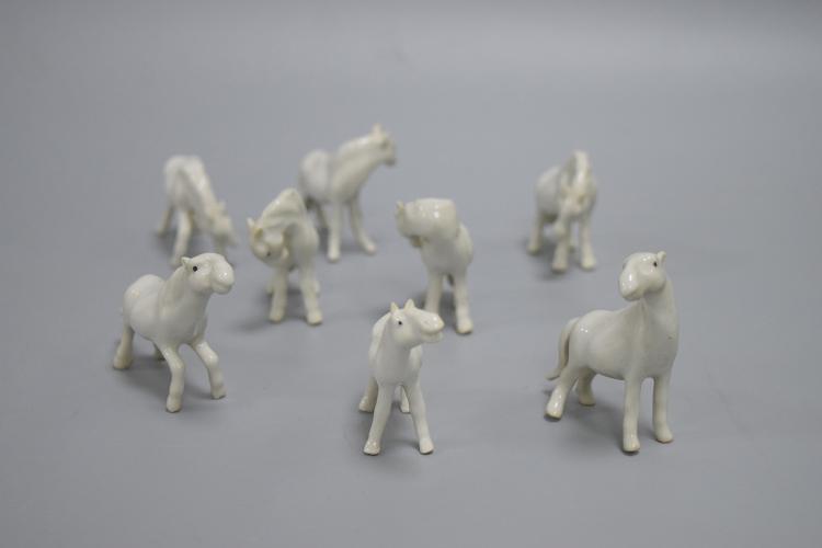 EIGHT CHINESE PORCELAIN OF WHITE GLAZE HORSES