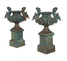 Pair of Exuberantly Modeled Cast Iron Garden Urns on Stands