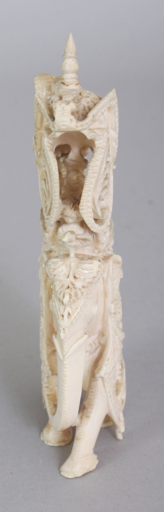 465ec7055 AN EARLY 20TH CENTURY INDIAN IVORY CARVING OF AN ELEPHANT BEARING A HOWDAH