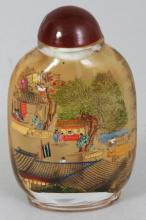 A 20TH CENTURY CHINESE INTERIOR PAINTED SNUFF BOTTLE & STOPPER, painted with detailed village scenes, 2.75in high.
