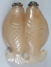 A CHINESE JADE DOUBLE SNUFF BOTTLE, with stoppers, the jade carved in the form of twin fish, 2in wide & 2.7in high.
