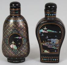 TWO CHINESE LAC BURGUATE SNUFF BOTTLES, with stoppers, each decorated with river landscape panels, each 2.6in high. (2)