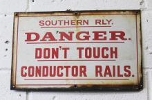 AN OLD RAILWAY ENAMEL SIGN. <br>1ft 8ins wide.