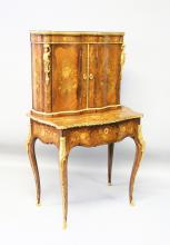 A GOOD 19TH CENTURY FRENCH KINGWOOD, MARQUETRY AND ORMOLU BONHEUR-DU-JOUR, the upper section with a pair of serpentine doors enclosing a shelf above a single long drawer with leather inset writing surface, supported on cabriole legs. <br>2ft 7ins wide x 1ft 6ins deep x 4ft 5ins high.