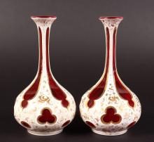 A PAIR OF BOHEMIAN PINK AND WHITE OVERLAY BOTTLE VASES with gilt decoration. <br>6.25ins high.