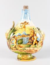 A URBINO PILGRIM FLASK, Possibly 16TH CENTURY, with mask handles, classical scene with many nudes beside a lake with buildings. <br>14ins high overall. <br>Note: Body intact, handles and base damaged and pieces missing.