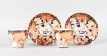 A PAIR OF ROYAL CROWN DERBY JAPAN PATTERN COFFEE CUPS AND SAUCERS. <br>Pattern 2444.