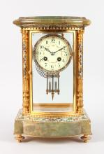 A GOOD 19TH CENTURY FRENCH FOUR GLASS CLOCK with champleve enamel decoration, eight-day movement, cream face painted with garlands, with bow front on four gilt feet. <br>13.5ins high.