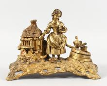 A GOOD 19TH CENTURY GILT METAL INKWELL formed as a young lady with a cottage style hutch feeding chickens.