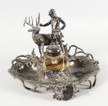 A GOOD 19TH CENTURY WMF PLATED INKWELL, a man with a deer, ivy and musical trophies.  12ins wide.