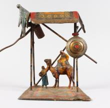 A BERGMAN STYLE COLD PAINTED SPELTER LAMP, modelled as Arab figure and a camel under a shelter. <br>9ins high.