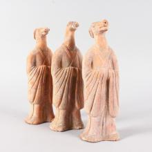 A SET OF THREE TANG POTTERY HEAVY FIGURES, HORSE AND TWO DOGS. <br>9ins high.