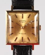 A GENTLEMAN'S GOLD ROTARY WRISTWATCH and leather strap.