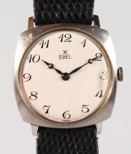 AN EBEL WRISTWATCH and leather strap.
