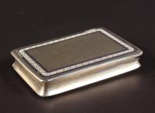 A CONTINENTAL .800 SILVER SNUFF BOX, the lid with key pattern decoration. <br>7.5cms.