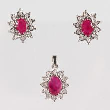A 9CT GOLD, RUBY AND DIAMOND PENDANT and PAIR OF EARRINGS.