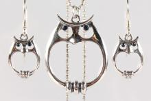 A SILVER SAPPHIRE SET PENDANT AND EARRINGS AS OWLS
