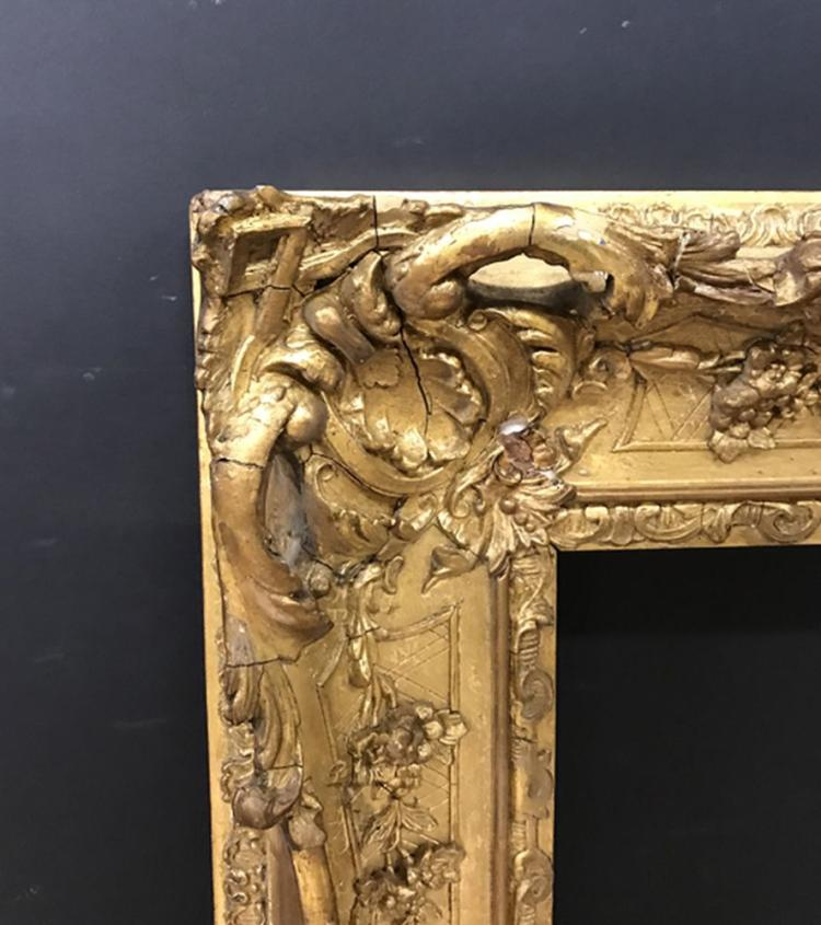 19th Century English School. A Gilt Pierced Swept Centres and Corners Composition Frame, 28.5