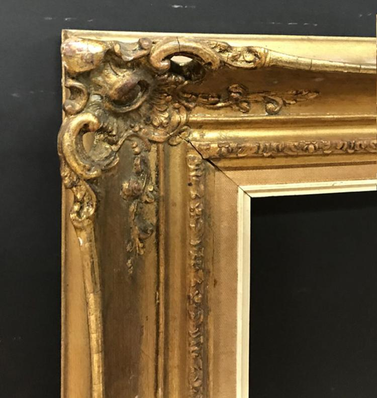 20th Century English School. A Gilt Swept Pierced Centres and Corners Composition Frame, 36