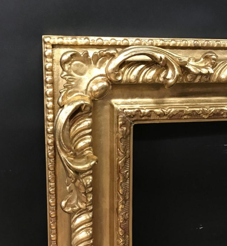 20th- 21st Century English School Style. A Carved Gilt Swept and Pierced Corners Frame, 30.25