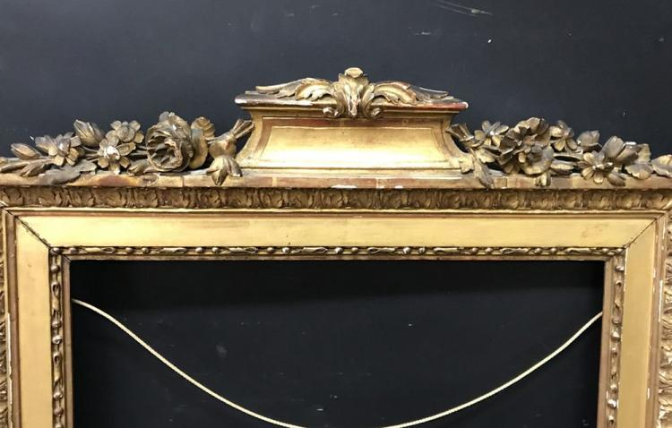 Late 18th Century French School. Carved Gilt Wood Frame with Carved Flower Pediment, 20.75