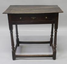 AN 18TH CENTURY OAK SIDE TABLE, with a twin plank top, single frieze drawer, supported on turned legs united by stretchers. <br>2ft 4ins wide x 1ft 5ins deep x 2ft 3ins high.