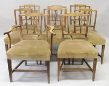 A SET OF EIGHT 19TH CENTURY ELM DINING CHAIRS, one with arms and one later, with stepped top rails, pierced back splat, overstuffed seats on stretchered tapering square legs.
