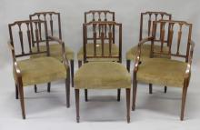 A SET OF SIX 19TH CENTURY MAHOGANY DINING CHAIRS, in Hepplewhite style, two with arms, shaped top rail, three vase shaped splats, overstuffed seats on tapering square legs.