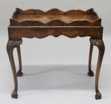 A GEORGE II DESIGN WALNUT TRAY TABLE, 20TH CENTURY, with lift off twin handled tray on a stand with carved cabriole legs and scroll feet. <br>2ft 4ins long x 1ft 6ins wide x 2ft 2ins high.