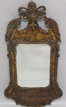AN 18TH CENTURY STYLE FRETWORK MIRROR, EARLY 20TH CENTURY, with carved, painted and gilded decoration. <br>3ft 5ins high x 1ft 10ins wide.