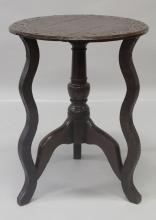 AN 18TH CENTURY AND LATER OAK TRIPOD TABLE, the circular top with carved and punched decoration. <br>1ft 10ins diameter x 2ft 4ins high.