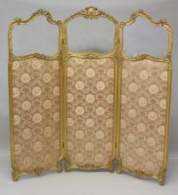 A 19TH CENTURY FRENCH GILT WOOD DRESSING SCREEN, the three panels all part glazed and floral fabric upholstered, on carved feet. <br>5ft 10ins high x 5ft 6ins wide.
