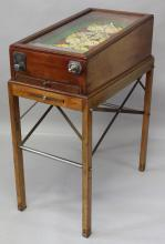 A GOOD LATE 19TH CENTURY BAGATELLE STYLE TABLE GAME by Ste. Ameublement Moderne, the gaming area painted with playing card devices, in a mahogany case with conforming stand. <br>2ft 6ins long x 1ft 8ins wide x 3ft 3ins high.