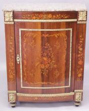 A 19TH CENTURY DESIGN ROSEWOOD, MARBLE, ORMOLU AND MARQUETRY CABINET, with a speckled polished marble top, above a frieze and single door inlaid with floral motifs on turned feet. <br>3ft 0ins wide x 1ft 8ins deep x 3ft 6ins high.