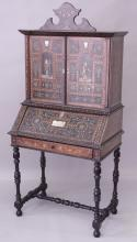 AN 18TH CENTURY ITALIAN EBONISED AND INLAID CABINET / BUREAU with a shaped cresting above a pair of doors profusely inlaid with pewter, bone and mother-of-pearl depicting figures in a doorway, above an inlaid fall flap enclosing a fitted interior above a long drawer on turned legs united by an