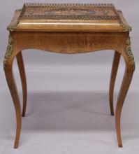 A 19TH CENTURY FRENCH WALNUT AND ORMOLU JARDINIERE with a marquetry inlaid cover, black japanned liner, supported on cabriole legs. <br>2ft 3ins long x 1ft 5ins wide x 2ft 7ins high.